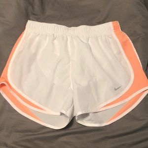 white & coral nike shorts